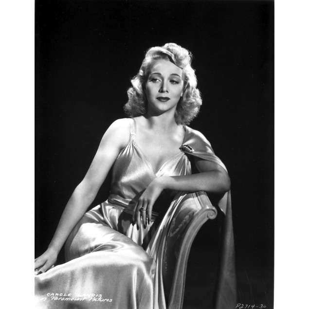 Carole Landis on a Silk Dress sitting and Leaning Poster