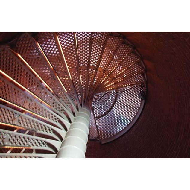 Light reflects off the stairs in the Cape May Point lighthouse. Poster