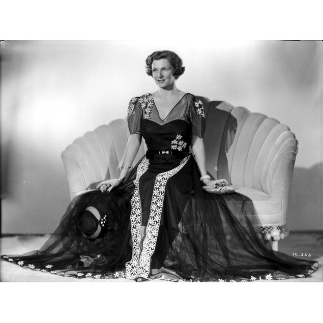 Irene Castle sitting on a Couch in Gown Poster