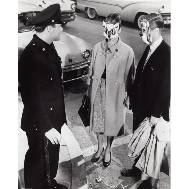 A film still of George Peppard and Audrey Hepburn wearing masks in Breakfas