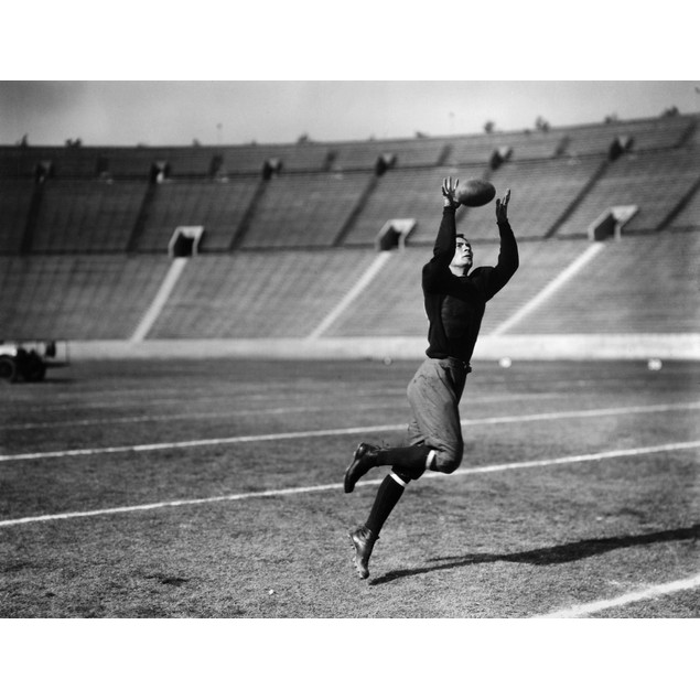 Football, 20Th Century. /Nan Unidentified American Football Player Making A