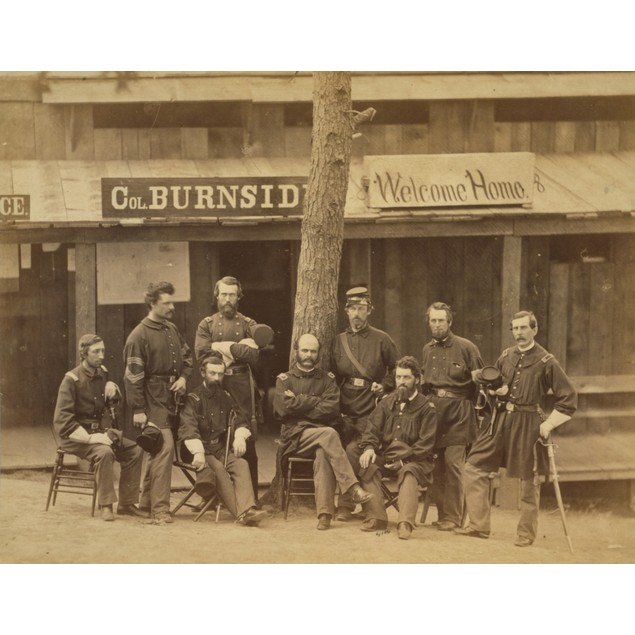 Ambrose Everett Burnside with eight officers posed in front of building, wi