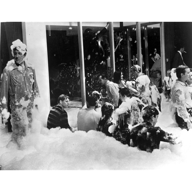 Film still of Peter Sellers covered in bubbles Poster