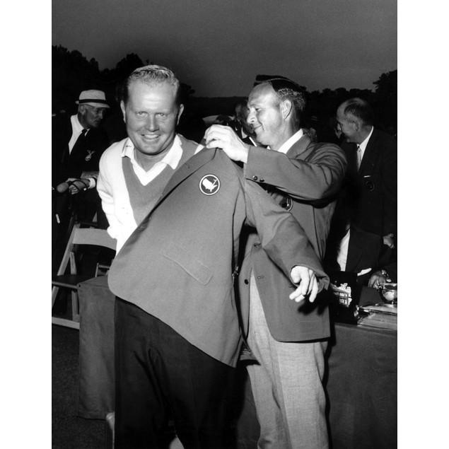 Jack Niklaus helping Arnold Palmer put on a jacket Poster