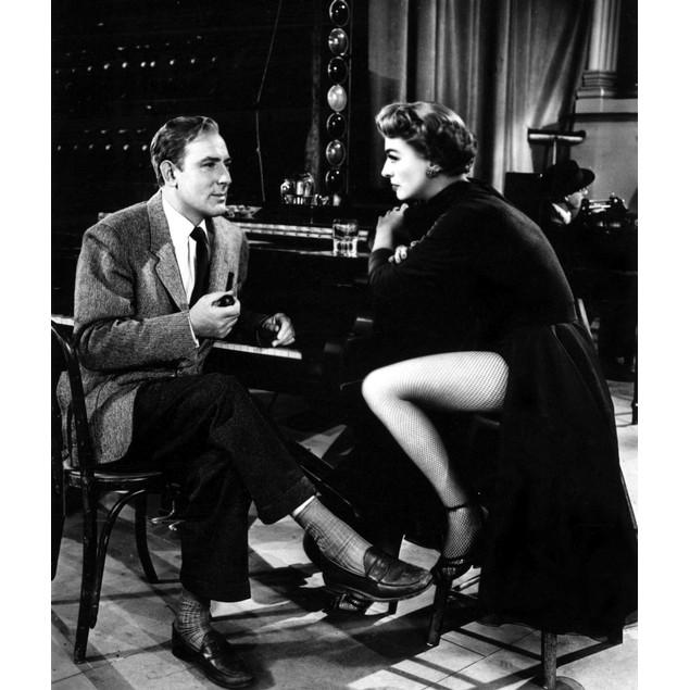 Joan Crawford and a man at a piano Poster