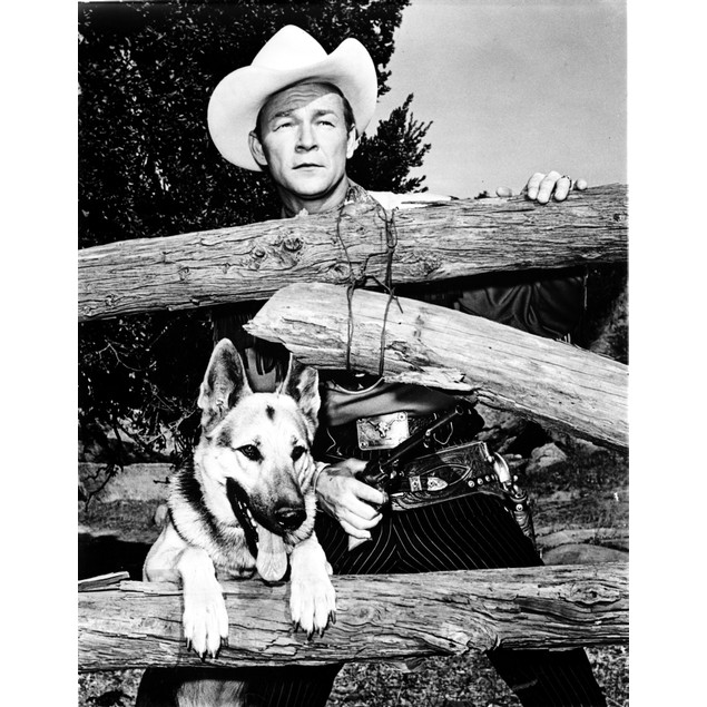 Roy Rogers in a cowboy hat with a dog Poster