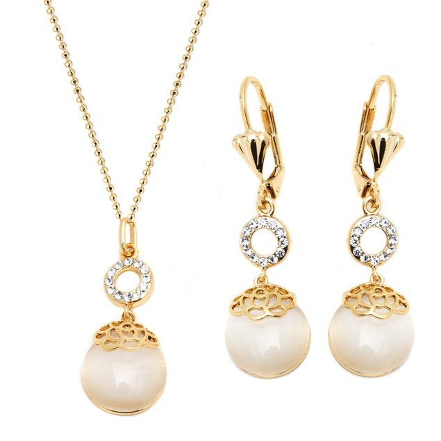 Gold and Crystal Elements Teardrop Earrings and Pendant Set