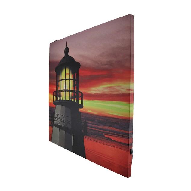 Light In The Sky Led Lit Lighthouse At Sunset Prints