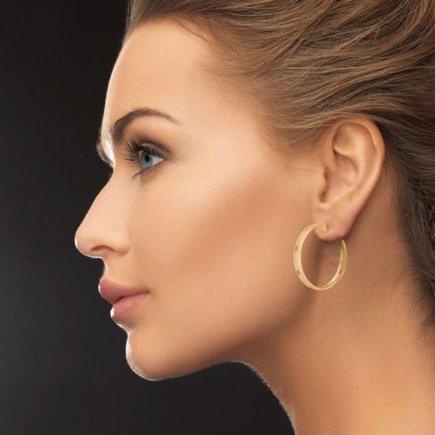 Gold Tone Hoop Earrings with Flower Cutout